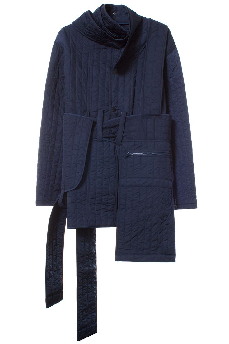 CRAIG GREEN EX JACKET Quilted snap front jacket with straps. Made in United Kingdom. 100% Nylon. SIZE & FIT Fits true to size. CRAIG GREEN A graduate of London's prestigious Central Saint Martins fashion design program