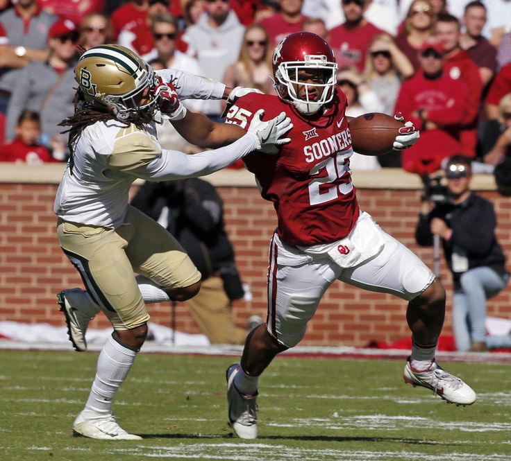 Oklahoma's Joe Mixon (25) pushes away tackler Baylor's Tion Wright (3) during a college football game between the University of Oklahoma Sooners (OU) and the Baylor Bears (BU) at Gaylord Family-Oklahoma Memorial Stadium in Norman, Okla., on Saturday, Nov. 12, 2016. Photo by Steve Sisney, The Oklahoman