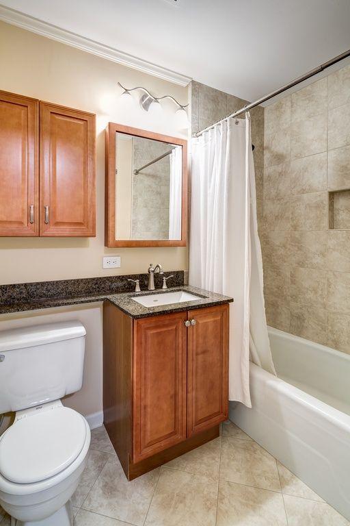 Craftsman Full Bathroom with Crown molding, limestone tile floors, tiled wall showerbath, Flush, Complex granite counters