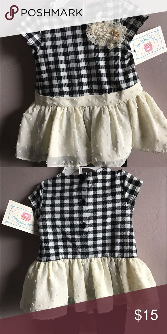 Marmellata Baby Girls Dress with Leggings Adorable black and white check dress with fabric flower broach detail, off white skirt and black leggings. Brand new with tags. Marmelatta Dresses Formal