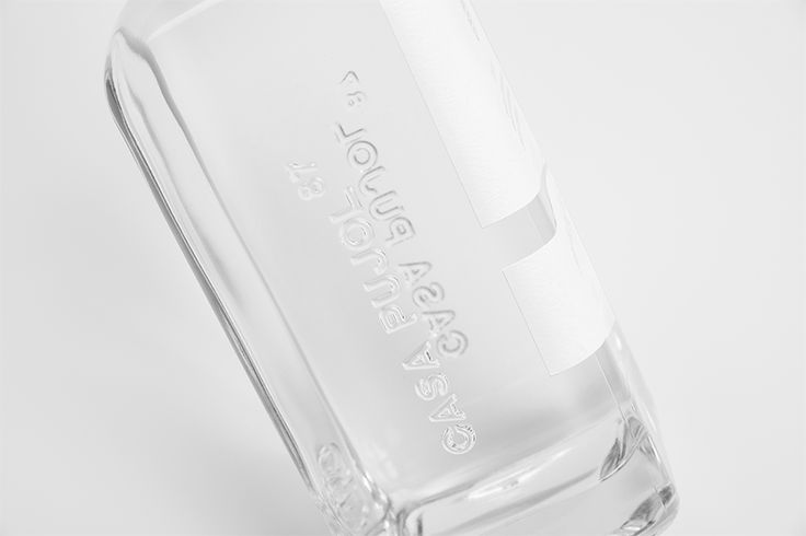 Tequila Casa Pujol 87. Embossed brand on glass bottle. Design by www.anagram.com