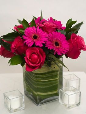 Gerbera Daisy Wedding Centerpieces | wedding centerpiece in a square glass container lined with draceana ...