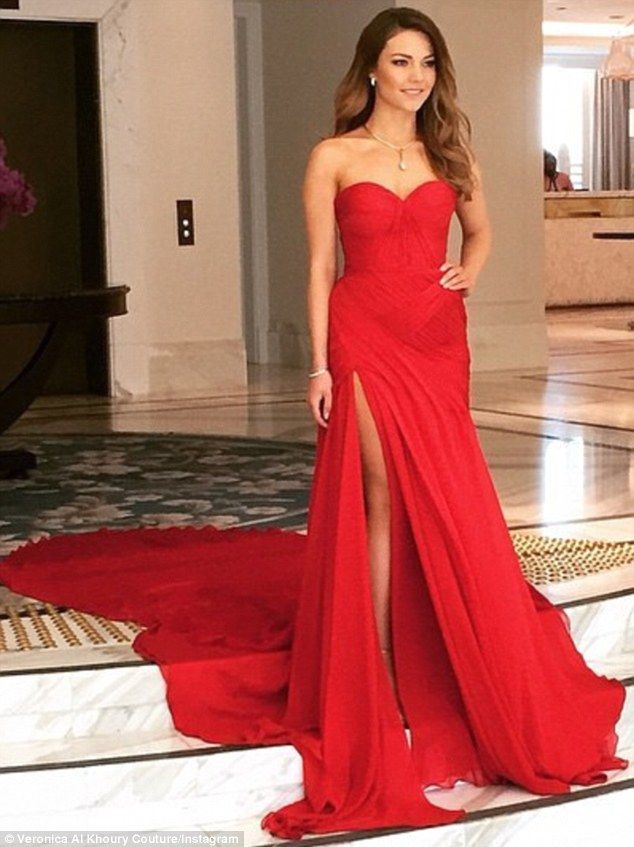Thigh-high split: As the 26-year-old sat in the gown with a thigh-high slit, her feet dist...