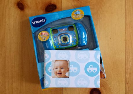 Watch out world!  This Big Brother has got a new baby to brag about!     He can capture baby's first moments with his own (kid-proof!) digital camera, and then he can save baby's photos in his own keepsake album.      A fun gift for the hospital or home, this kit gives the big big a way to show off his new sibling!    V-tech Kidizoom Digital Camera requires double-A batteries.