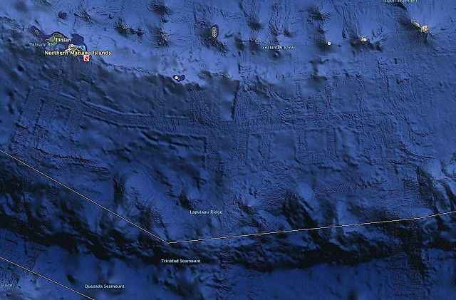 "Massive Underwater Structure May Be Alien Base Says UFO Researcher, Found Near Saipan, Video  Scott Waring, author of UFO Sightings Daily,  says, ""The massive walls seem to go for about 50 miles, but long ways is about 250 miles. Sure these anomalies could be an ancient Asian civilization that sank under the ocean long ago""  or a hidden UFO base."