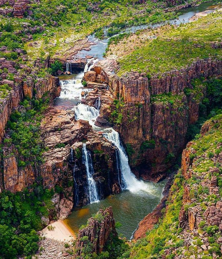 "Twin Falls, Kakadu National Park, Australia. This beautiful waterfall is located deep in the heart of Kakadu National Park. During the Northern Territory ""wet season"" this particular waterfall is only accessible by the air as all of the access roads are closed due to flooding, and apparently the surrounding waters have crocodiles in them."