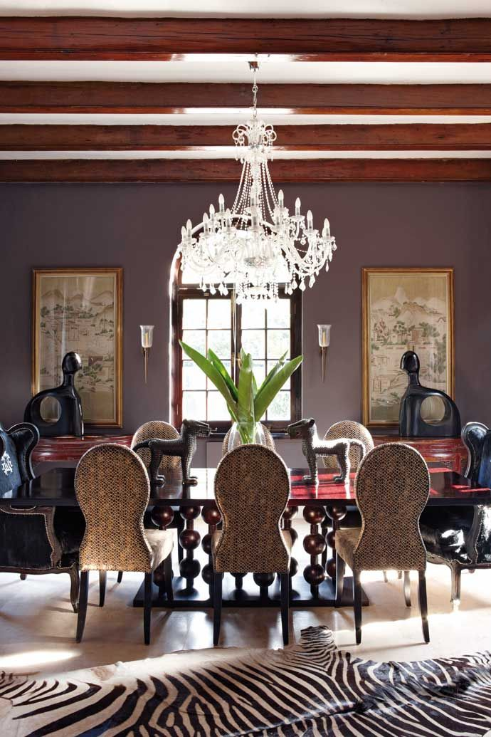 This formal dining room has an Abacus table and high-backed Spoonback chairs covered in Aldeco fabric from Hertex Fabrics (hertex.co.za).