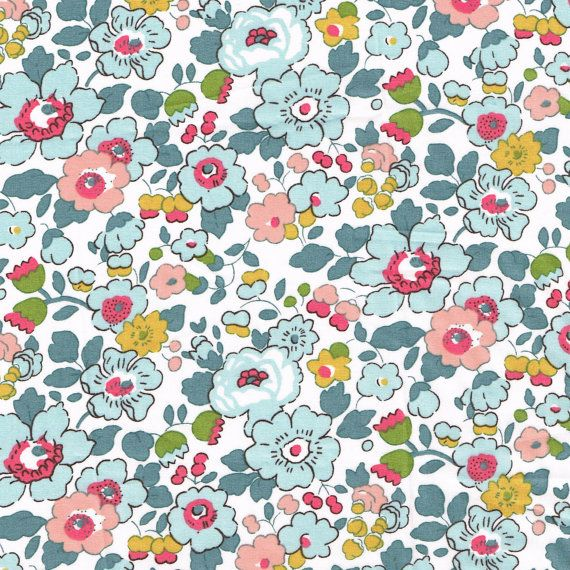 Pretty vintage style floral print: Betsy from Liberty of London in this lovely pale blue and apricot colourway.    Size: Half Yard: 18 x 54