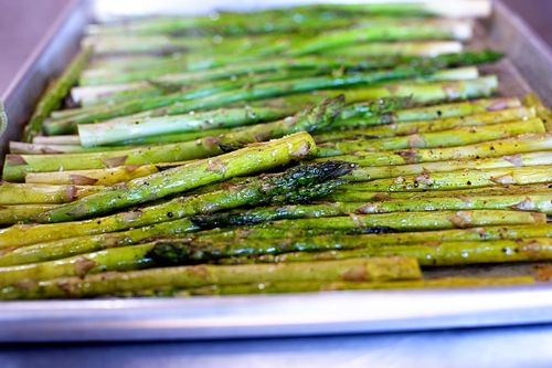 Oven roasted asparagus.  Love this.  i do it the same way except I add garlic and shredded (not grated) parmesan cheese.  Pairs perfect with BBQ smokey sweet salmon.