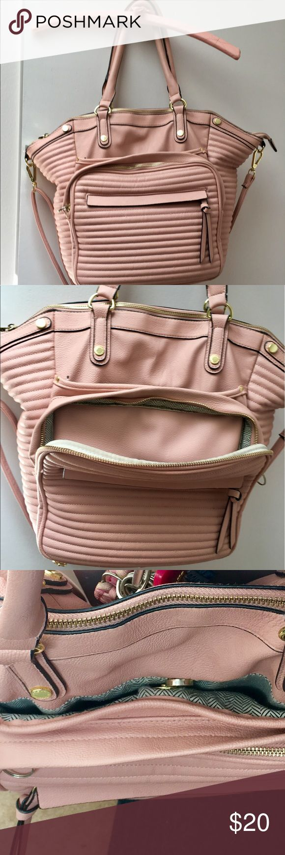 Steve Madden Pink Leather Large IPad bag purse You can fit so much in this awesome bag! I love this bag! Has a place for everything! For your smartphone, makeup, wallet, IPad or whatever brand, it keeps it very safe! There's a little tack that popped out and where I live there is not one shoe repair shop so I couldn't bring it in to get a brad put back in. Shouldn't cost a thing to get done. I live in a rural area. But there's so much life to this amazing bag! I only used it for about a…