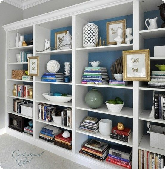 add moulding to Ikea bookshelves and paint the backs  {build three self units so it sits lower}                                                                                                                                                      More