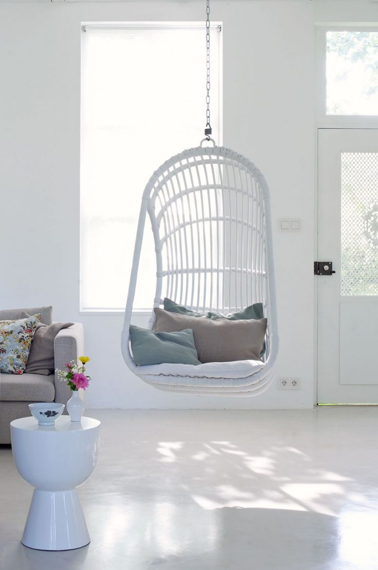 White hanging chair | Styling Marianne Luning | Photographer Tjitske van Leeuwen | vtwonen May 2010
