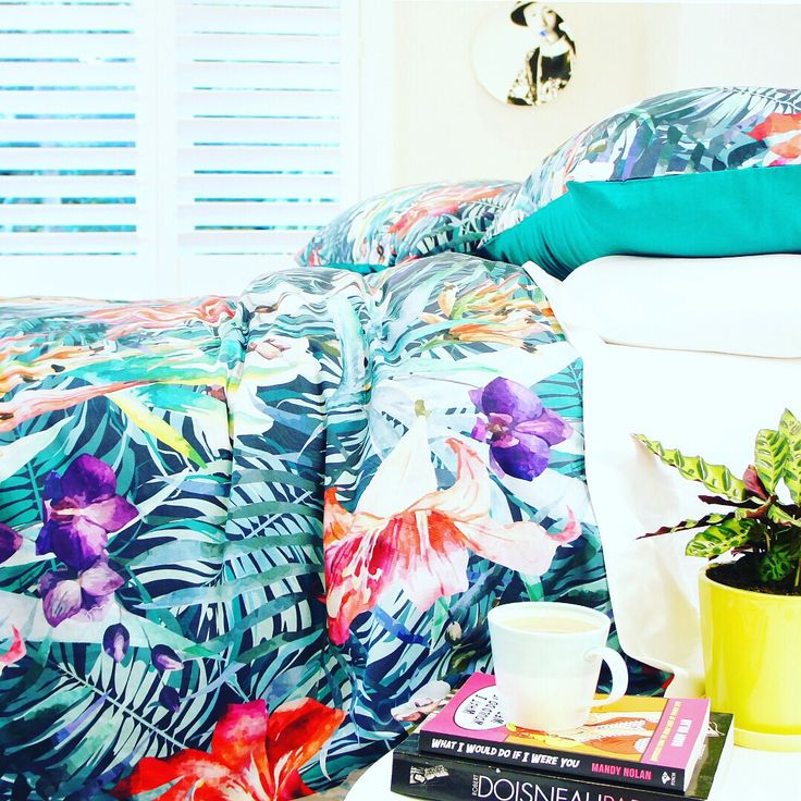Revive your room with a simple duvet change and some fresh flowers!