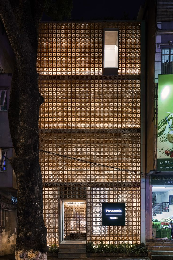 Located within Dong Da district, Hanoi, the newly constructed gallery and lighting showroom uses a perforated terracotta façade to create a simple yet significant impact on the surrounding landscape. The gallery is located on the top floor overlooking a large neighbouring tree, while the slit skylights expose the roof garden. This offers a space for architects and design professionals to interact. Upon entering the building, visitors are greeted with a large void. The showroom is caref...