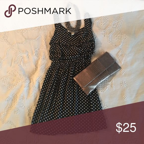 Flirty polka dot dress This flirty polka dot dress is a class piece for a day at work then a night out for a glass of wine. It is cinched at the waist and has understated ruffles at the bust. The tag says can, but it fits more like a small. American Rag Dresses