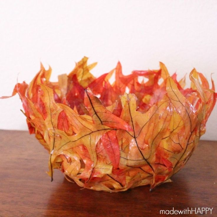 DIY Fall Leaf Bowl - Simple craft using leaves from your yard creates a fun DIY centerpiece to your FALL decor. You'll need leaves, a balloon and some glue and…