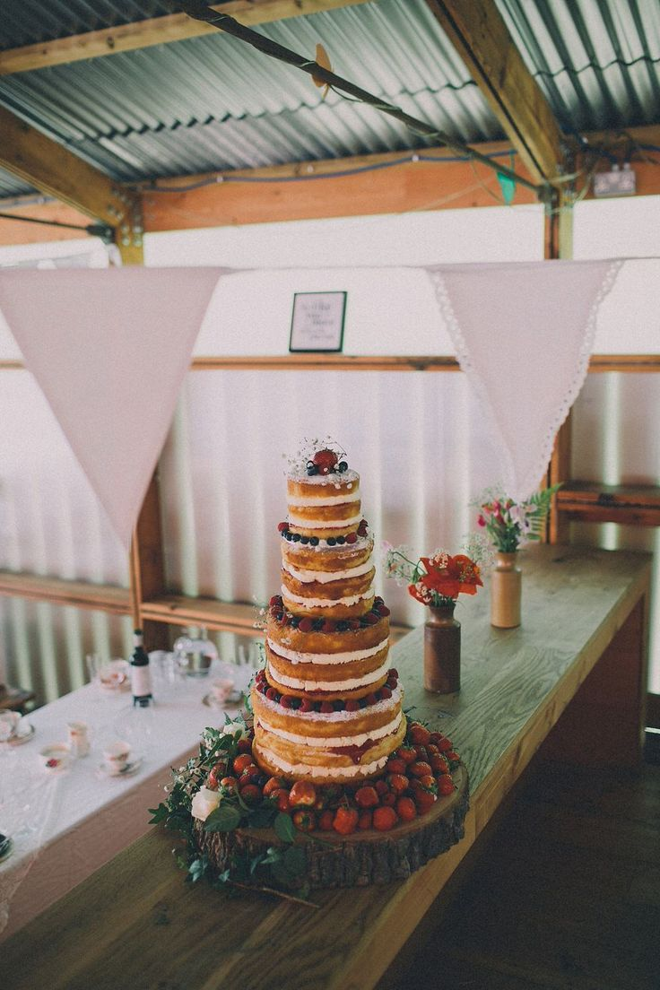 Rustic Outdoor Wedding's naked starawberry cake. Photo by Lucius Fox.