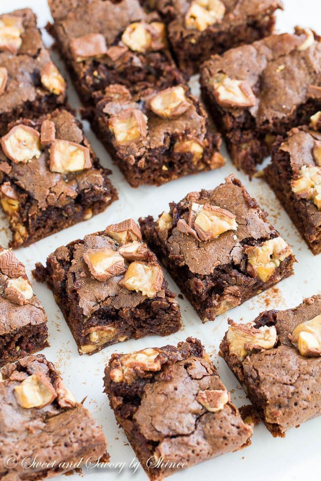These snickers brownies are fudgy in the center with thin crackle top and loaded with gooey chewy snickers bites! Brownie heaven!