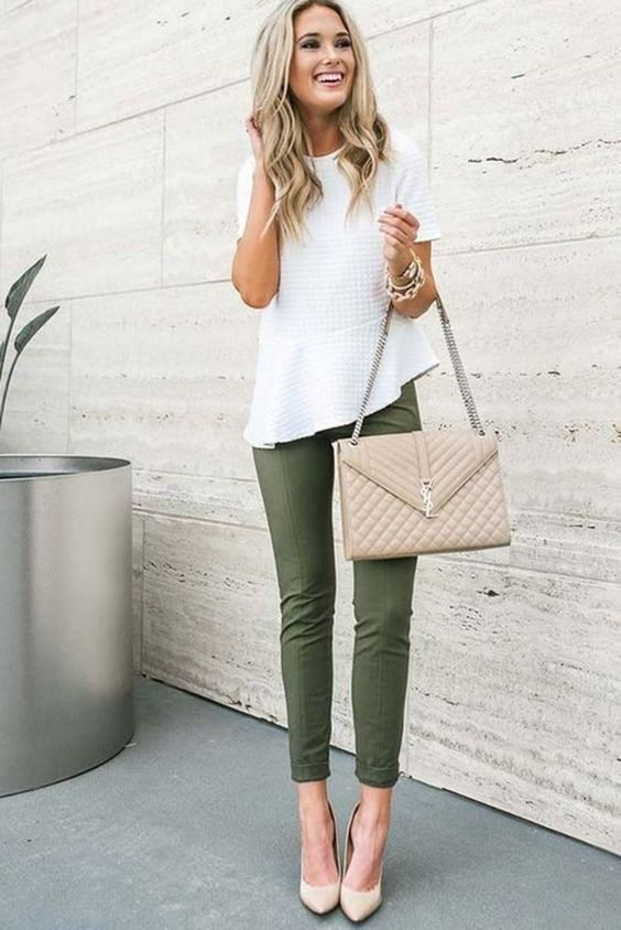 Professional casual style woman fashion outfit. Green trousers, white blouse, nu…