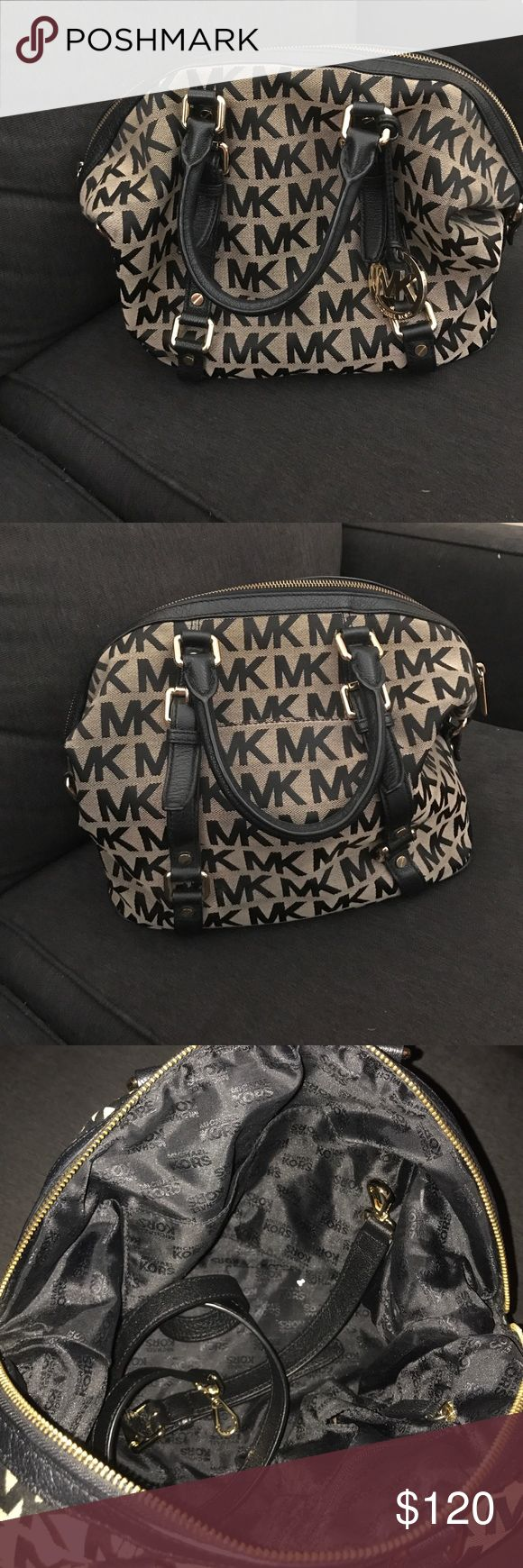 Michael Kors purse Beige and black purse. Comes with shoulder strap. Michael Kors Bags Shoulder Bags