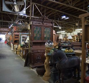 tobacco barn in Asheville N.C. 77,000 sq. ft. of shopping # (828) 252-7291  75 Swannanoa River Road  Asheville, NC 28805 There are new things mixed in with the antiques but there are some amazing antiques here. I hate it when antique stores have new things mixed in.. it leads to buyers remorse when people think they got an antique and get home to find out its a reproduction. If you know your stuff you will be fine in here though.