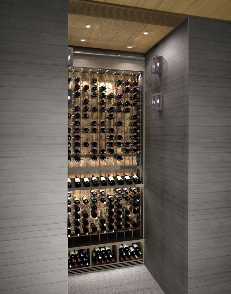 Small space, huge impact! This custom wine cellar by Papro Consulting Ltd. www.paproconsulti... featuring the Cable Wine System www.cablewinesyst... certainly makes a statement!