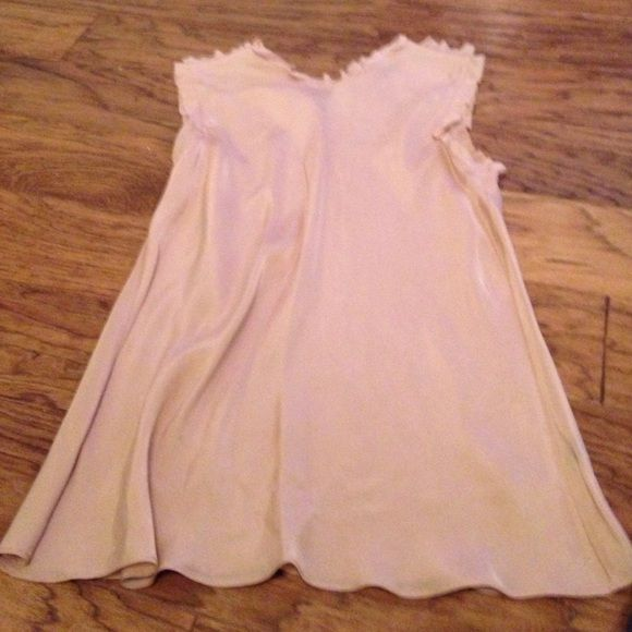 Sleeveless Nude top Nude top with ruffles on neck and arms. It's 100% Rayon. Club Monaco Tops