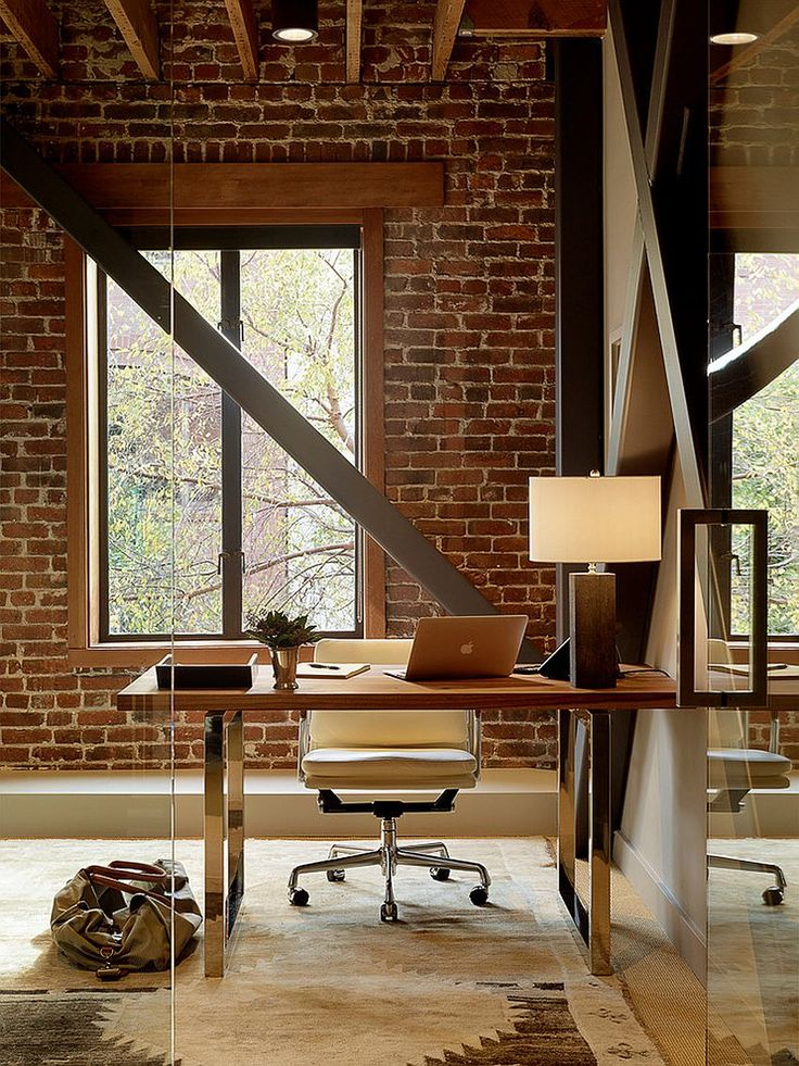 Exposed brick wall backdrop is perfect for the industrial home office [Design: Palmer Weiss Interior Design]
