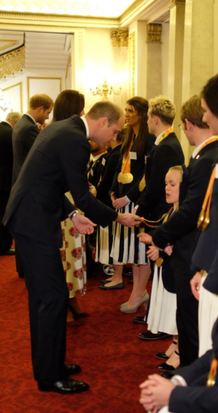 Prince William was even pictured inspecting the gold medal of champion swimmer Ellie Simmo...