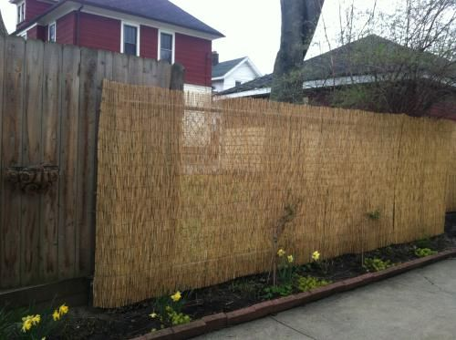 bamboo fence panels are easy to install and can be used to visually divide your garden