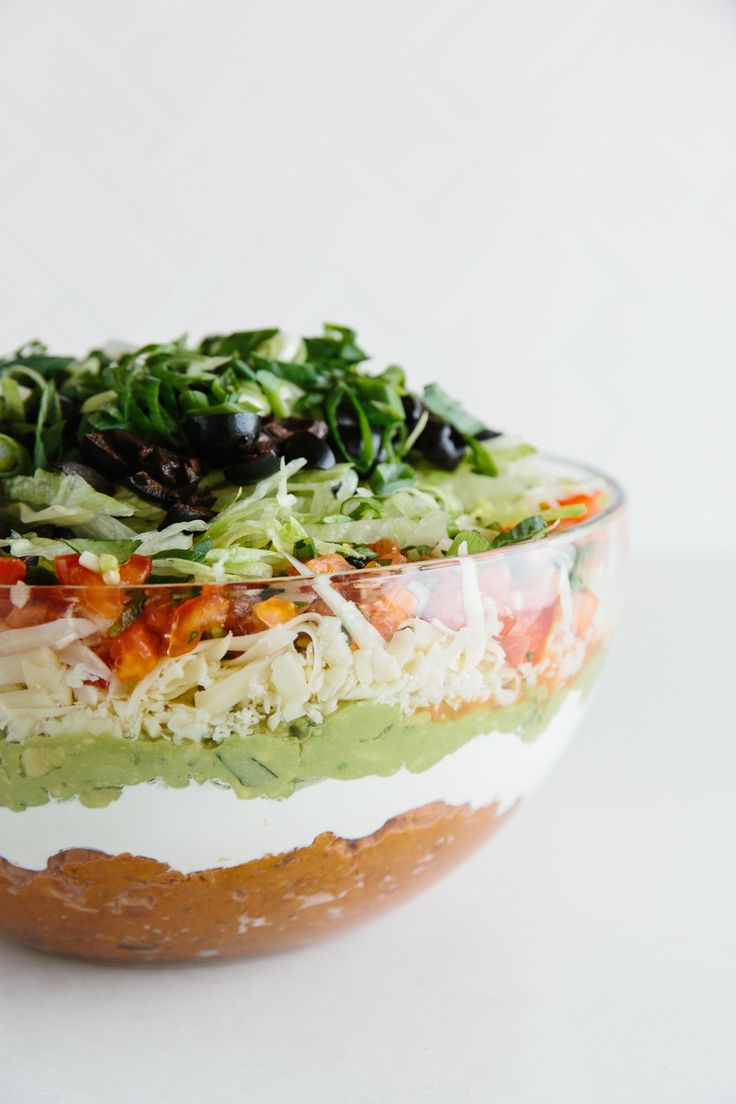 Quick, can you name all seven layers in a seven-layer dip? If you can, you're invited to join me on Team Party Dip. This team knows that a party is only as good as its best dip, and a classic seven-layer dip with all its spicy Southwestern goodness is a guaranteed win at the party. Even if you're skeptical of all those layers, I'm willing to bet we'll find you hovering over the dish within five minutes of walking in the door.