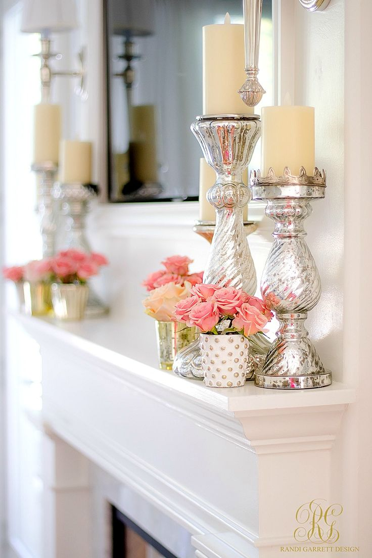Tips to Warm up your Home after Christmas fresh pink flowers on a white mantle with mercury glass pillar candles are just the thing!