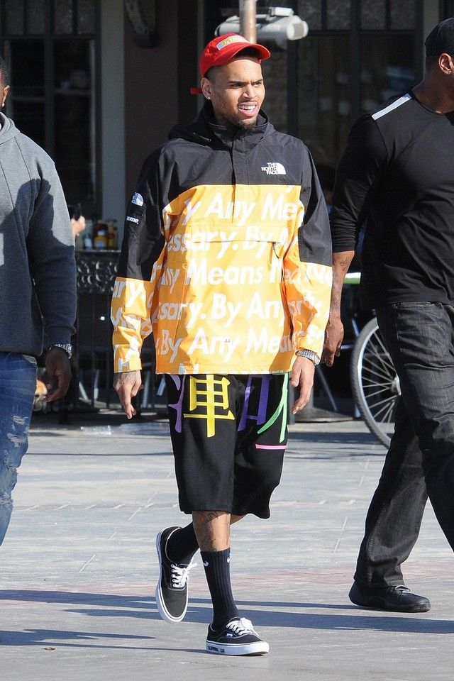 Chris Brown wearing  Supreme x The North Face By Any Means Mountain Pullover, Vans x Supreme , Nike Dri-Fit Cushion Crew Socks, Opening Ceremony Symphony Patch Cap, Audemars Piguet Royal Oak Quartz