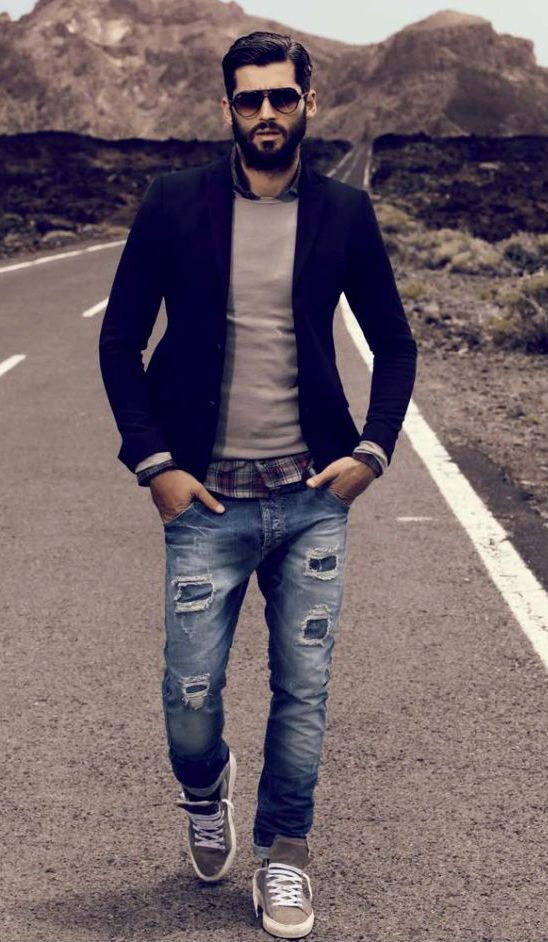 Perfect the smart casual look in a deep blue sportcoat and blue distressed jeans. For a more relaxed take, rock a pair of grey low top sneakers.  Shop this look for $208:  http://lookastic.com/men/looks/sunglasses-crew-neck-sweater-blazer-longsleeve-shirt-jeans-low-top-sneakers/4866  — Black Sunglasses  — Beige Crew-neck Sweater  — Navy Blazer  — Burgundy Plaid Longsleeve Shirt  — Blue Ripped Jeans  — Grey Low Top Sneakers