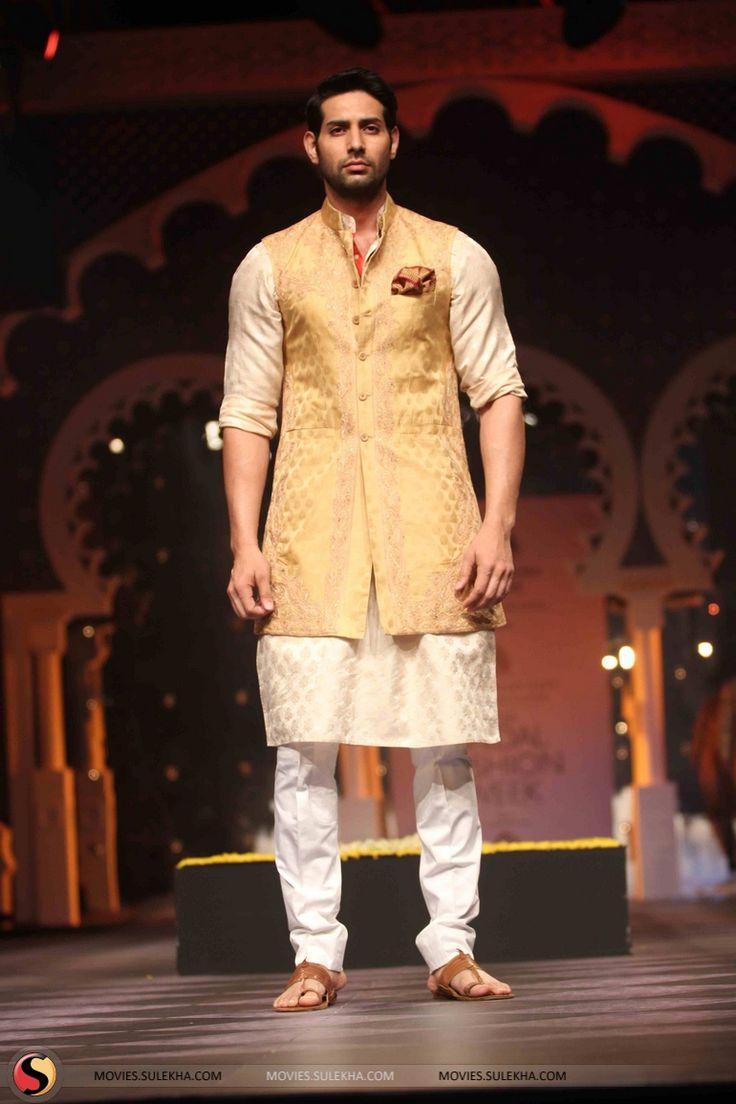 Achkan by designer Raghavendra Rathore. Shop for your wedding trousseau, with a personal shopper & stylist in India - Bridelan, visit our website www.bridelan.com #Bridelan #Indiangroom