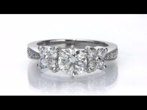 Cute  UniqueEngagementRing with round center diamond This engagement ring can acmodate any size and any