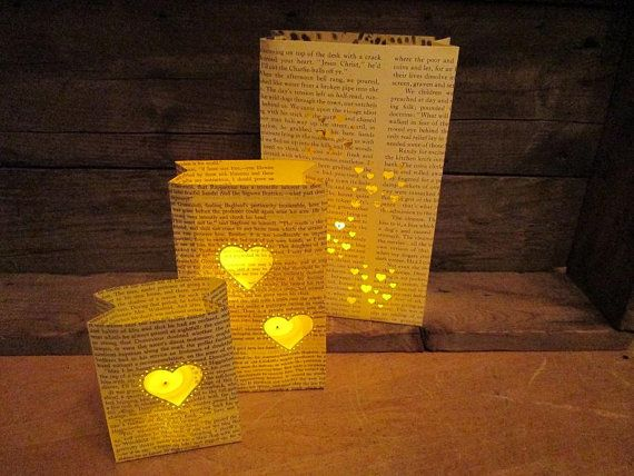 luminaries out of book pages is awesome. have snowflakes di-cut into them and it fits your theme and personality.