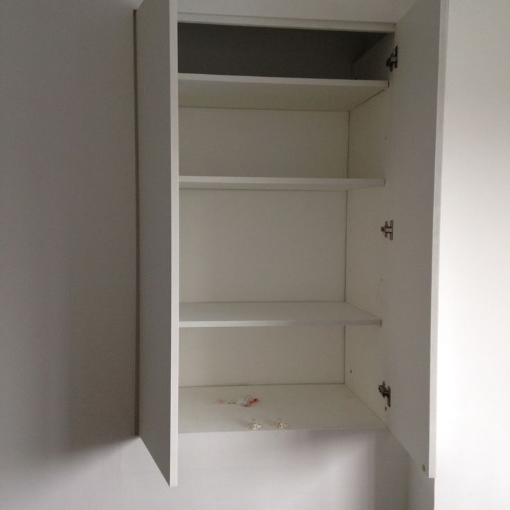This customer wanted a discrete cupboard build in a per ulnar space above her staircase