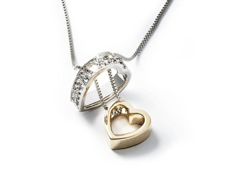 Two hearts interlink to become one. A small token to keep close to your heart