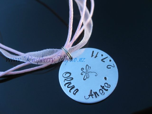 This 22mm Aluminium or Sterling Silver Newborn Pendant is hand-stamped with your babies personal details.