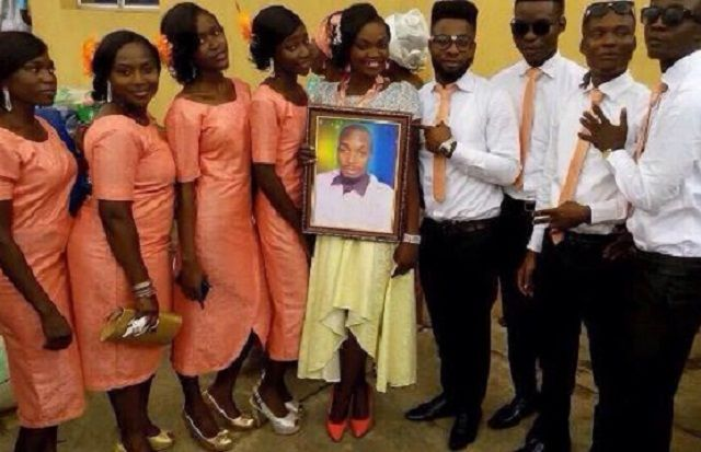 [PHOTOS]: LOL...This Lady Is Happily Married To A Portrait | TNN.ng
