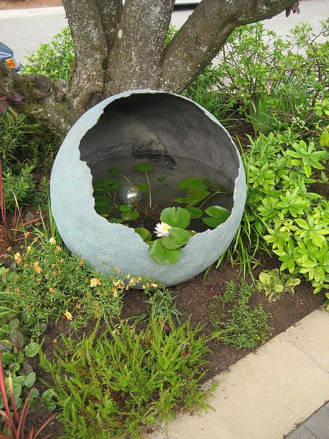 http://www.littleandlewis.com/commissioned.html This is one AWESOME concrete sphere used as a water garden.