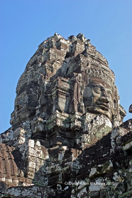 Face Tower, Angkor: Jayavarman VII, who ascended to the Khmer kingdom's throne at Angkor in 1181 A.D. erected the site for Buddhist worship,although it later was renovated and used as a Hindu temple.