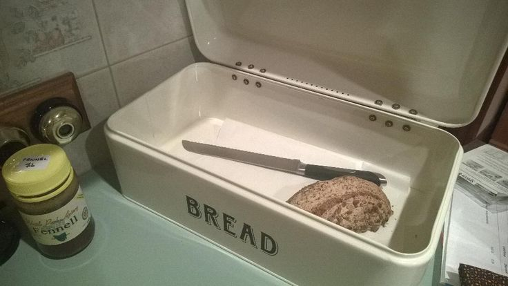 """""""[I keep] sourdough in a metal box, paper liner eventually dries out, no mould. The [piece of] loaf in there is millet with millet malt and dried millet leaven, topped with sunflower and flax."""" —@cgjs"""