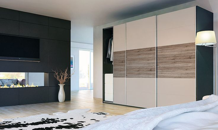 Fitted sliding wardrobe matt cashmere and rustic woodgrain design. Ideal for bedroom, home office and living room space. Made to measure design and ideal storage solution.