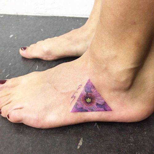 Flower triangle tattoo on the left foot. Tattoo artist: Hongdam