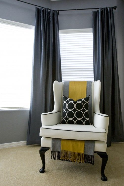 Getting creative with throws can yield beautiful results. This white wing chair trimmed in black piping is gorgeous on its own, but when paired with a double dose of throws draped across the back and threaded through the seat cushion, the piece sings a livelier tune.