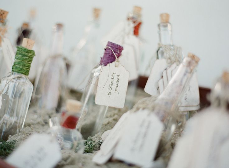 #DIY Wedding | #EscortCards - Like a Message in a Bottle | See the wedding on SMP: http://www.stylemepretty.com/california-weddings/malibu/2013/02/13/malibu-wedding-at-adamson-house-from-michael-anna-costa/ Michael + Anna Cost Photography