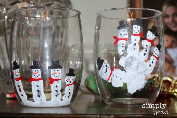 Easy and fun DIY winter craft for kids, using only paints and clear glasses to create a simple outdoor scene with snowmen. Makes great presents for the family or holiday decorations that toddlers can make with mom's help!