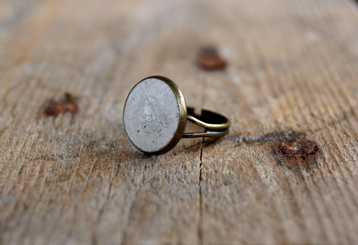 """Simple, super stylish and light - hip design for everyday wearing with ring """"Bastian"""".  Industrial chic meets art nouveau elegance - light gray concrete is caressed by gentle sweep of the bronze..."""